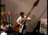Dude rocks out on a monster sized Flying V guitar.