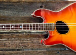 Left-handed acoustic bass guitars