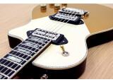 Orange sort une guitare custom construite par Jason Burns