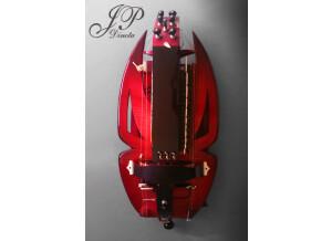 Vielles Dinota Vielle Solid Body Rouge : 3 Chanterelles (avec relevage mécanique des cordes), 2 Bourdons, 1 Chien, 1 Mouche